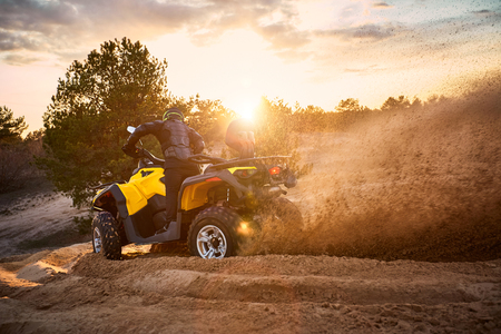 Photo for Racing in the sand on a four-wheel drive quad. - Royalty Free Image