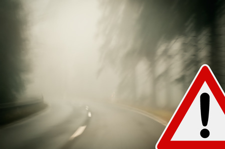 Bad weather driving - Foggy morning on a winding country road