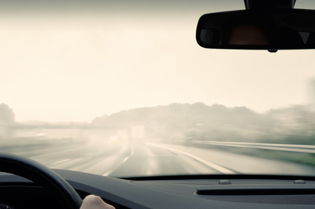 Photo pour Bad Weather Driving - Driving on a Freeway on a Rainy and Misty Day - image libre de droit