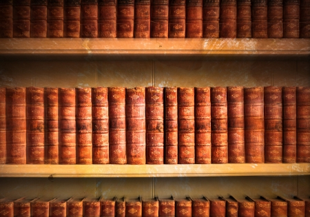 Collection of old weathered books in vintage tones