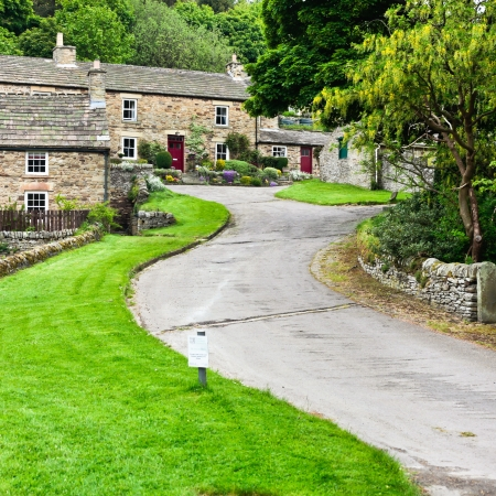 Hillside stone cottages in Blanchland village, Northumberland
