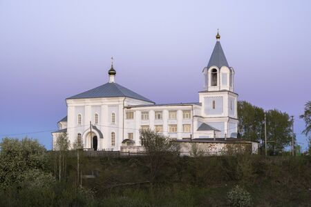 Holy Trinity church in the Russian countryside in the late evening
