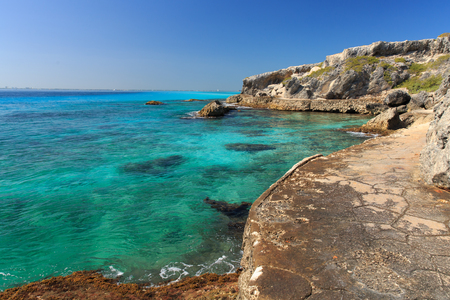 A trail winds around the beautiful blue Caribbean water on Isla Mujeres, Mexico.