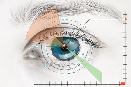 Photo pour Scanner on blue human eye - image libre de droit