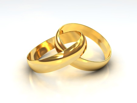 A Pair of golden Wedding Rings on white background