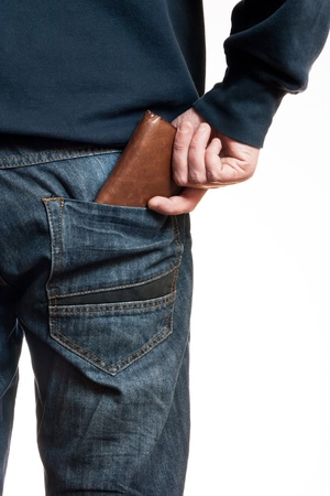 A man taking his wallet in his pocket to illustrate the economy, consumption, financial crisis