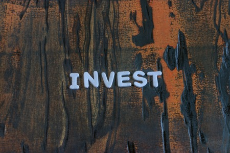 invest written in white lettering