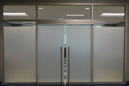 Photo pour clean white office hallway with industrial doors and windows on the walls - image libre de droit