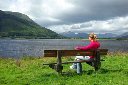 Yung woman meditating on a bench 2