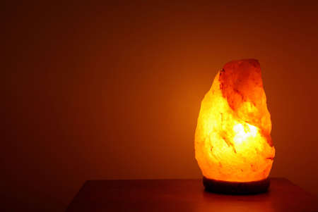 Crystal salt lamp lit in a room to make the atmosphere zen