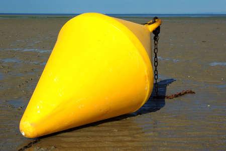 Boundary yellow buoy on a beach in Brittany (France)
