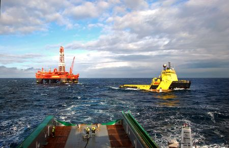 Photo for Anchor handling of an Semi Submersible Oil Rig in the North Sea. - Royalty Free Image