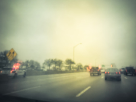 Photo pour Blurred motion road accident on wet rainy day near Dallas, Texas, USA. Fire trucks and police car support and rescue injured people. Bad driving condition and severe weather concept - image libre de droit