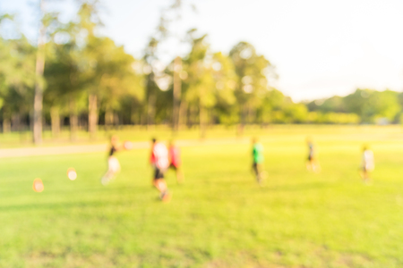 Photo for Blurry background Latin America boys playing soccer at park during sunset - Royalty Free Image