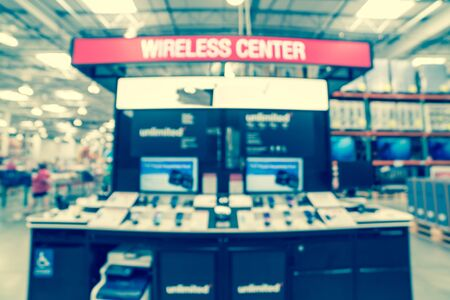 Photo for Filtered image blurry background variety of cell phones at American wholesale store - Royalty Free Image