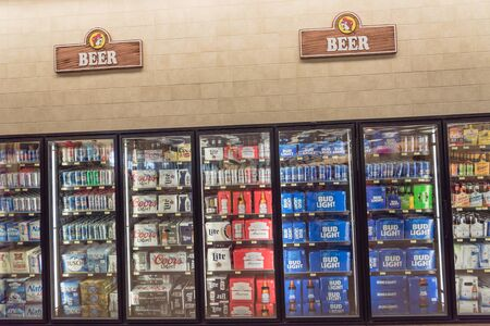 Photo pour Bottles and cans of domestic and imported beer on display at American convenience store - image libre de droit