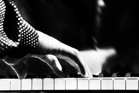 A black man playing piano closeup