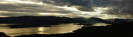 Loch Lomond is a freshwater Scottish loch  It is the largest inland stretch of water in Great Britain by surface area  The loch contains many islands