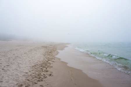 Foggy weather by the sea  Baltic beach in Leba, Poland