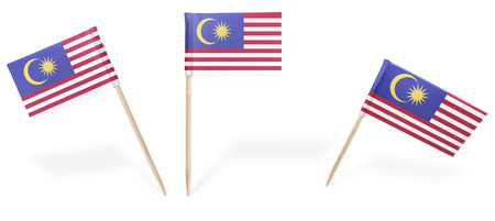 Small cocktail flags of Malaysia in different positions isolated on white.(series) . Also easy to use as a design element :)