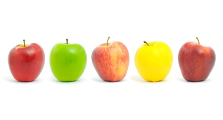 Fresh apples of different colors , isolated on white.