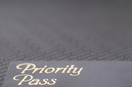 Black priority pass card. A business background.