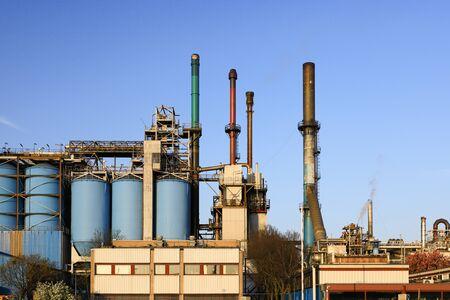 Photo pour Petrochemical industrial plant power station at sunset, close up of a factory building, - image libre de droit
