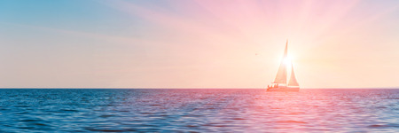 Photo pour Banner 3:1. Sailboat in the sea in the evening sunlight over sky background. Luxury summer adventure or active vacation concept. Copy space. - image libre de droit