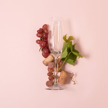 Foto de Alphabet. Letter I made of wineglasses with rose and white wine, grapes, leaves and corks lying on pink background. Wine degustation concept. Flat lay. Top view - Imagen libre de derechos