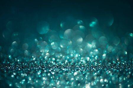 Photo pour Abstract glitter lights on turquoise background. Christmas greating card. Christmas or New Year celebration concept. Copy space. Soft focus - image libre de droit