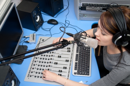 Photo for A radio DJ announces news in a studio - Royalty Free Image