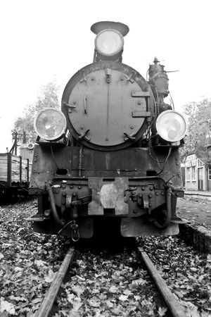 part of old steam train in black and white