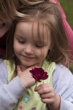 A beautiful young girl with a flower
