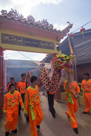 GEORGETOWN, PENANG/MALAYSIA – CIRCA FEBRUARY 2016: Dragon dance performance at floating temple at clan jetty.