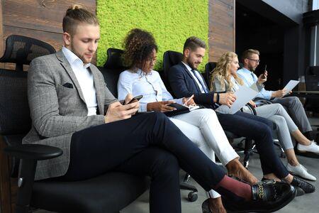 Photo pour Modern business people waiting for job interview. - image libre de droit