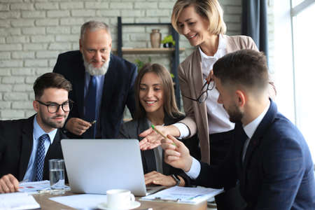 Foto de Startup business team on meeting in modern bright office interior and working on laptop - Imagen libre de derechos