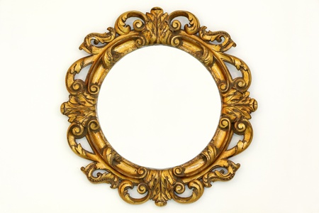 Oval gold baroque style frame on beige wall