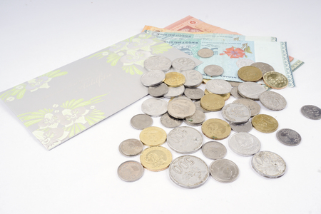 Coins and notes on table. Saving and business concept.