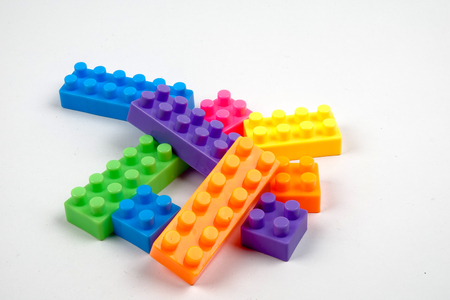 Foto de Plastic building blocks isolated on white background - Imagen libre de derechos