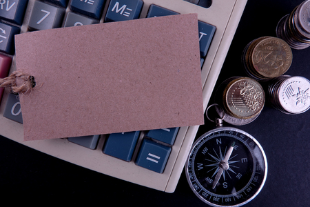 Business and Finance Conceptual with tag,compass and coins. Copy space