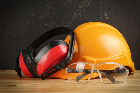 Photo for Safety Personal Protective Equipment(PPE) on a rustic black background. - Royalty Free Image