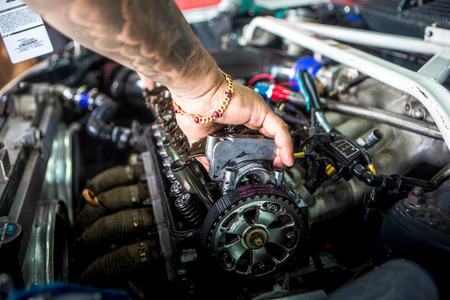 Mechanic checking the timing belt