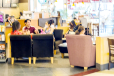 Blurred of People sit drinking coffee and talking in a cafe for backgound
