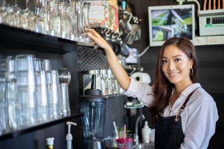 Photo pour Asian women Barista smiling and using coffee machine in coffee shop counter - Working woman small business owner food and drink cafe concept - image libre de droit