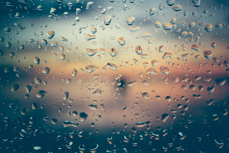 Drops of rain on glass with filter effect retro vintage styleの写真素材