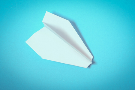 paper planes on blue background