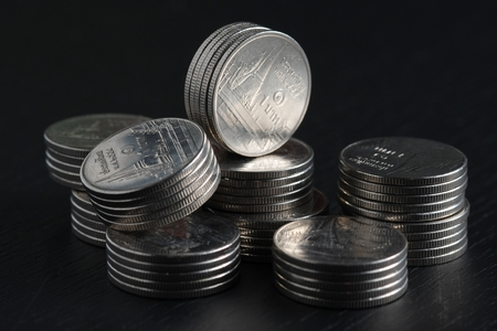business finance. save money for investment concept coins on black background