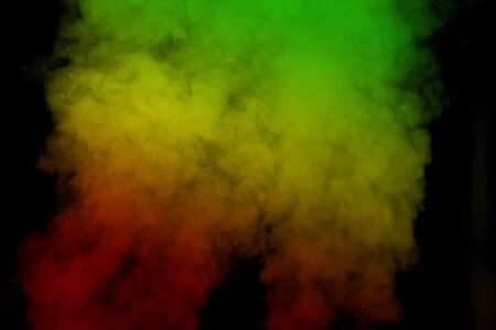 Foto de abstract background smoke curves and wave reggae colors green, yellow, red colored in flag of reggae music - Imagen libre de derechos