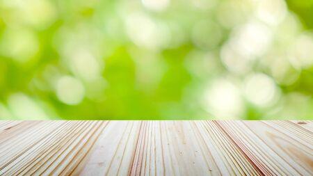Photo pour Wooden table top on green nature background - image libre de droit