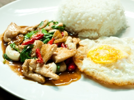 fried basil chicken and fried egg